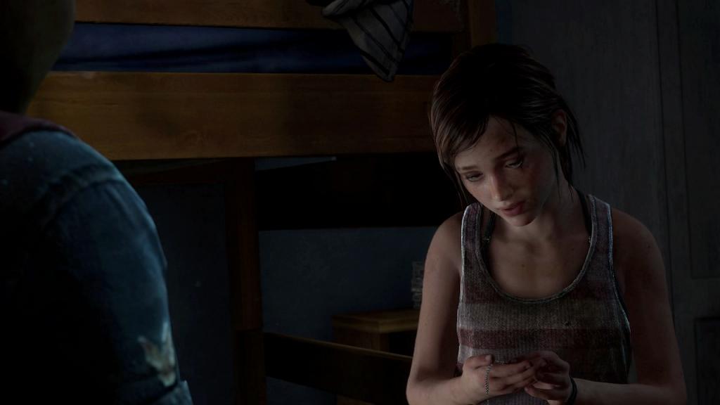 Ellie looks at firefly pendant_1390403729