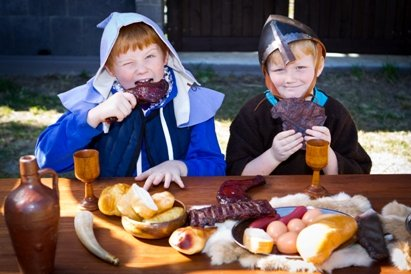 Feasting at the Kids' Medieval Fun Day,one of the best days for kids at a Brisbane Museum