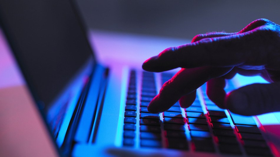 15 Jul 2014 --- Silhouette of male hand typing on laptop keyboard at night --- Image by © Andrew Brookes/Cultura/Corbis