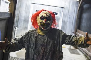 A U.S soldier wearing a scary clown mask takes part in a Halloween party at the US military camp Bondsteel near the town of Ferizaj on October 30, 2015 AFP PHOTO/ARMEND NIMANI        (Photo credit should read ARMEND NIMANI/AFP/Getty Images)