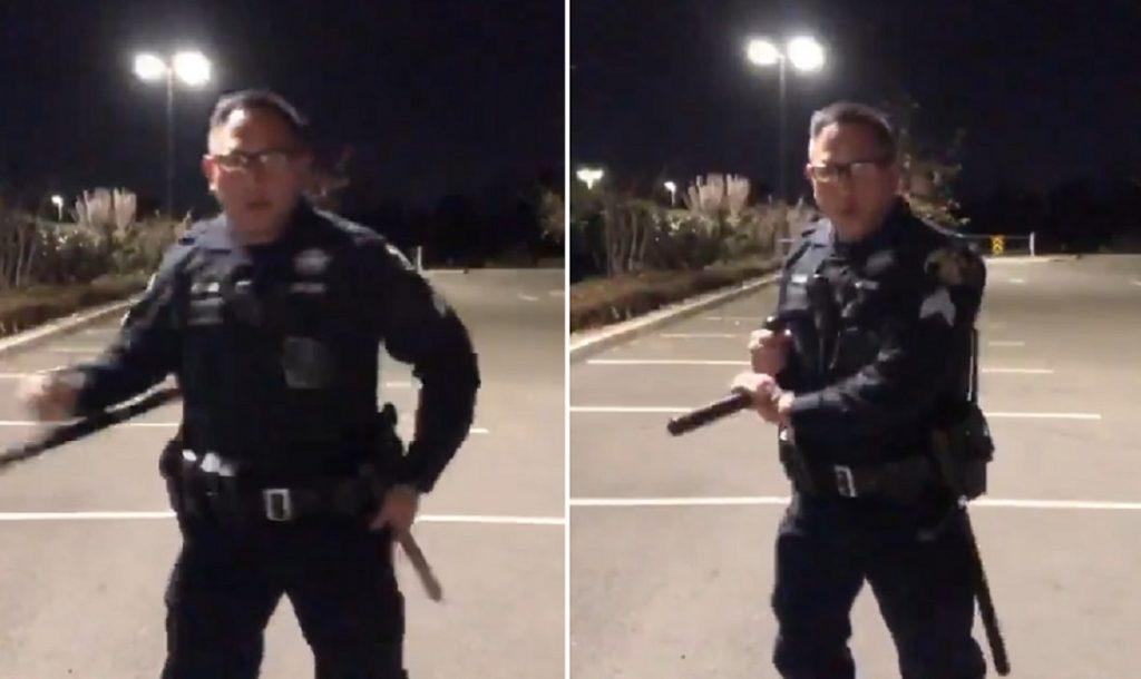 полицейский с дубинкой тонфа